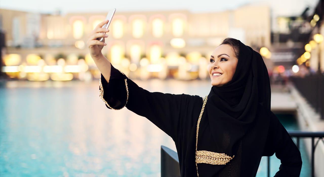 A Saudi woman takes a selfie for social media
